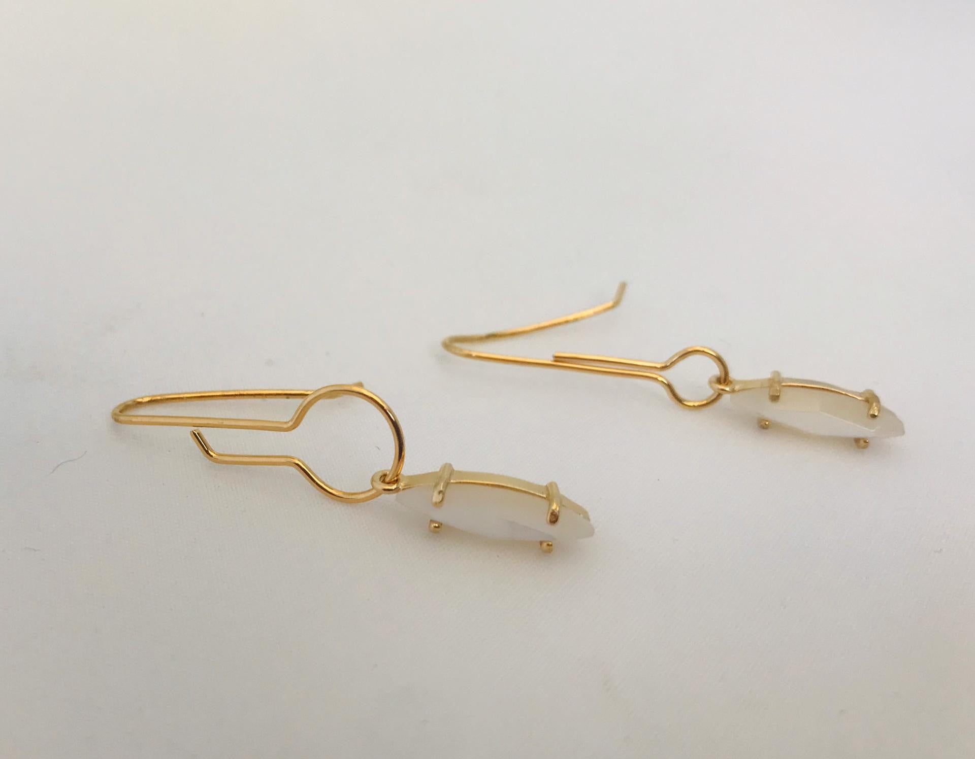 Wouters & Hendrix -  gold plated asymmetric earrings with mother of pearl