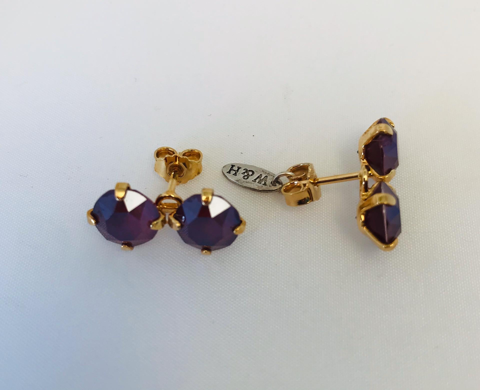Wouters & Hendrix - gold plated double purple crystal earrings
