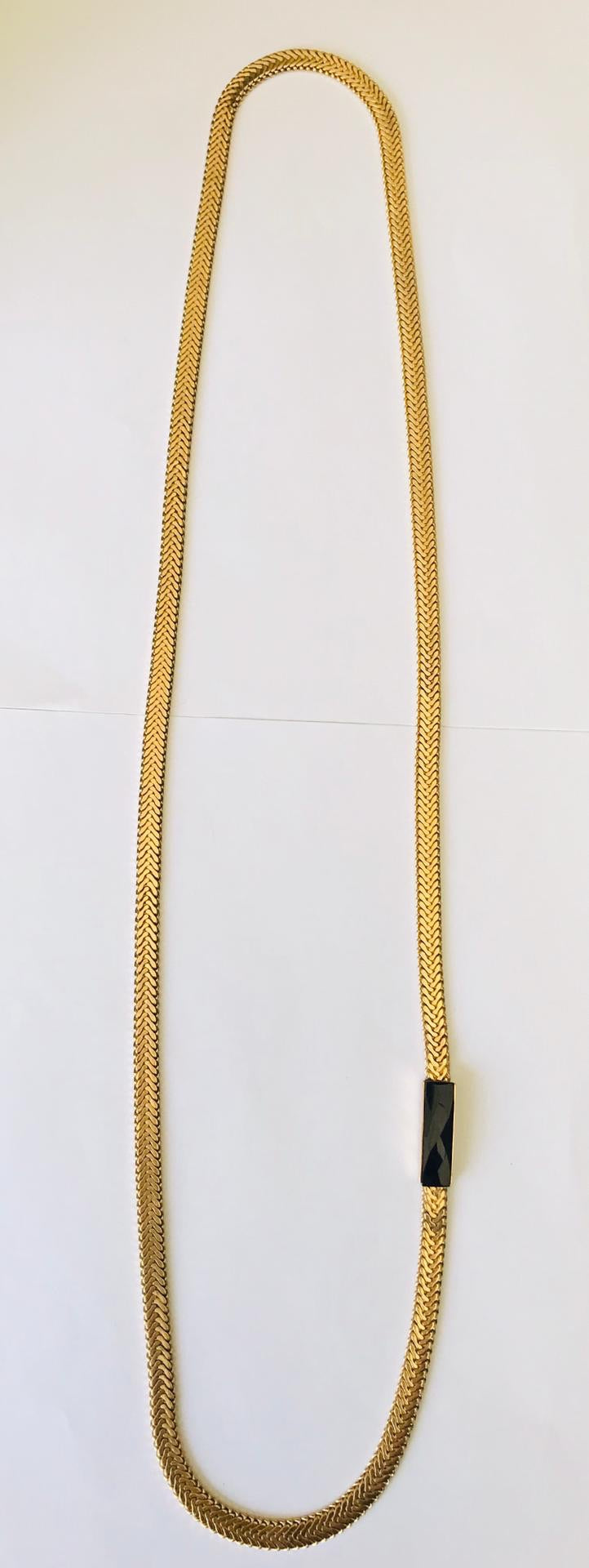 Wouters & Hendrix - long gold plated necklace with faceted onyx stone