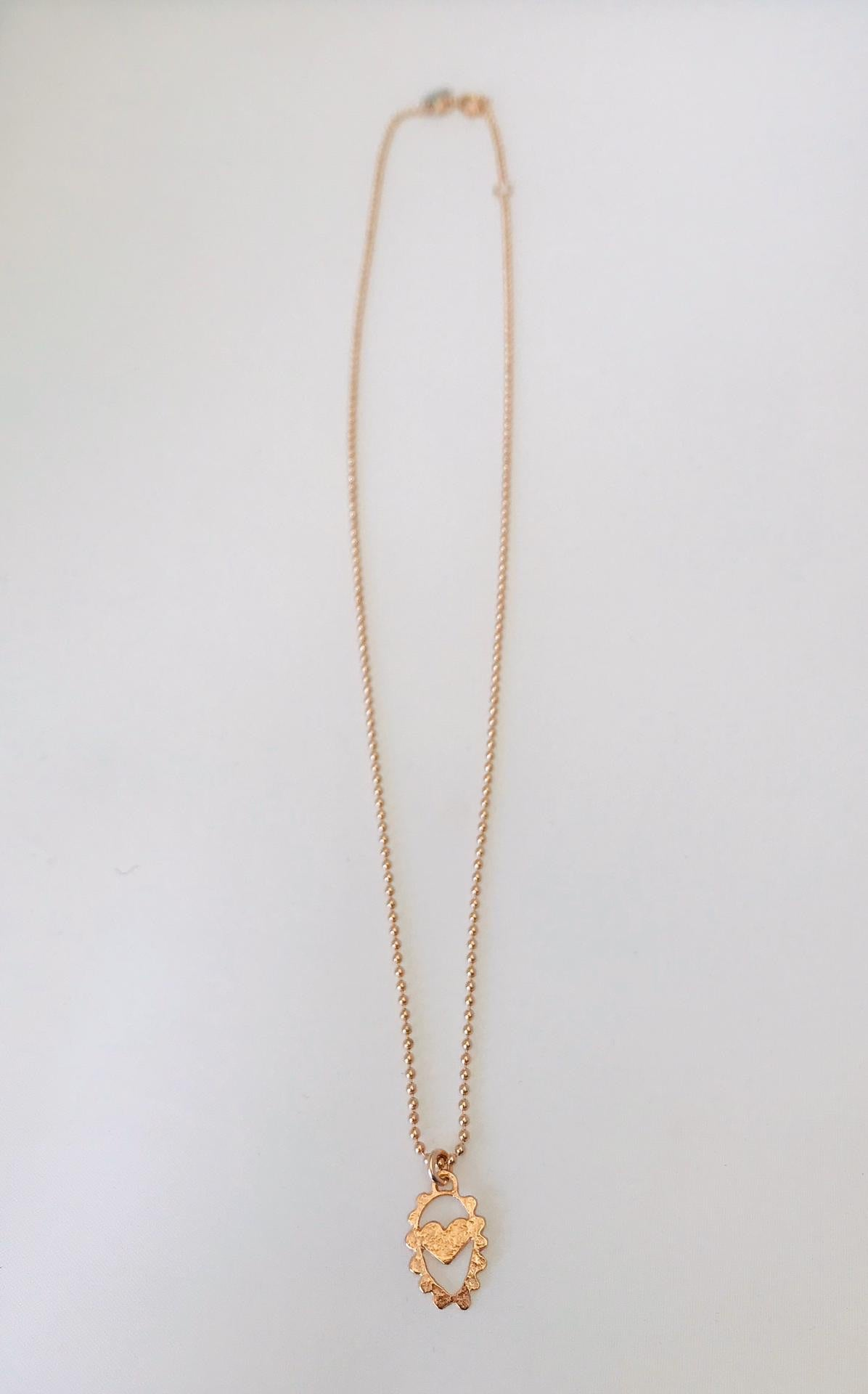 Wouters & Hendrix - pink gold plated heart necklace
