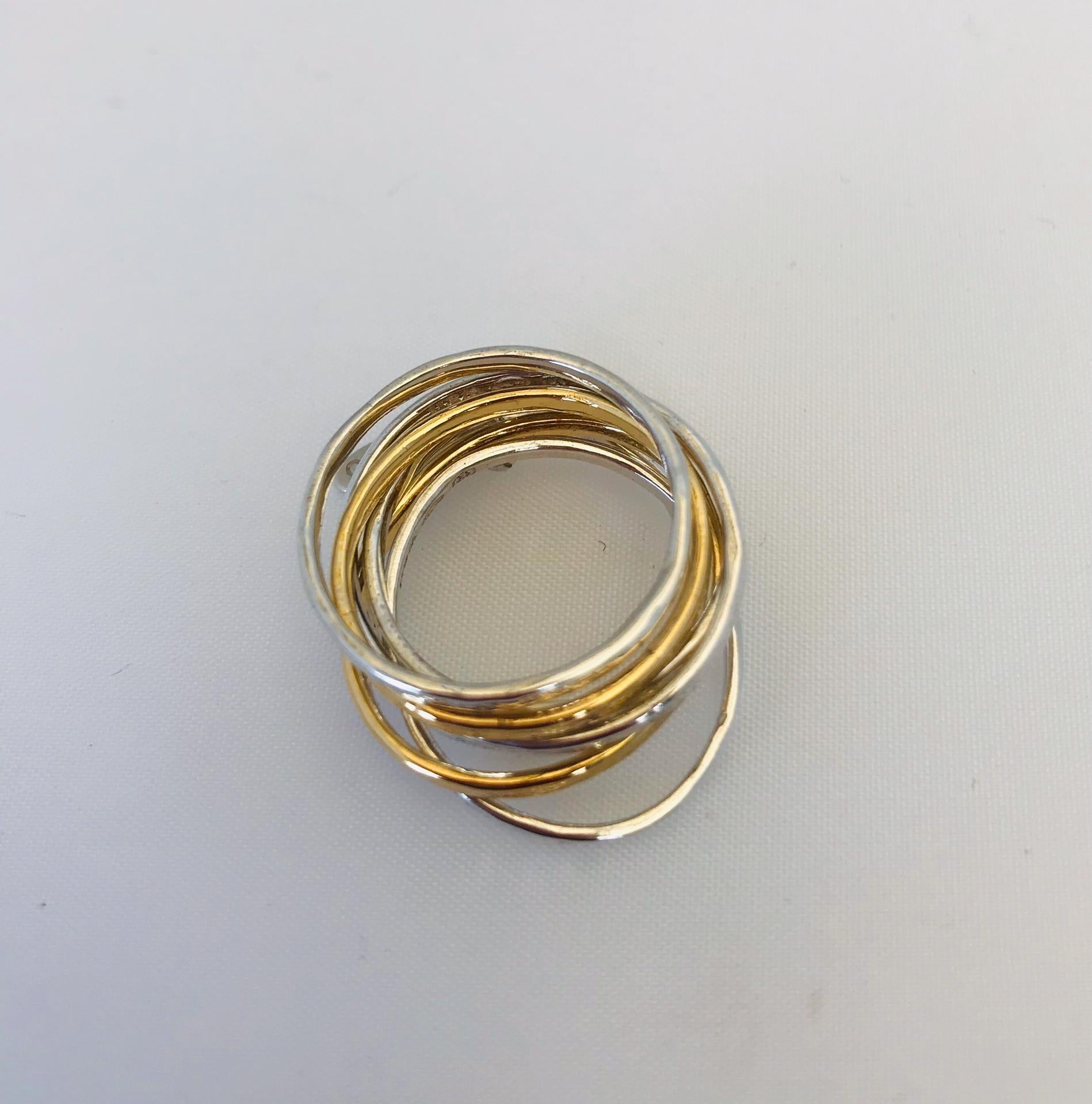 this 7 mix ring by Wouters & Hendrix. The ring include 7 separate rings of which 5 are silver and 2 gold plated. 2 of the silver rings and 1 gold plated ring have an oval shape.
