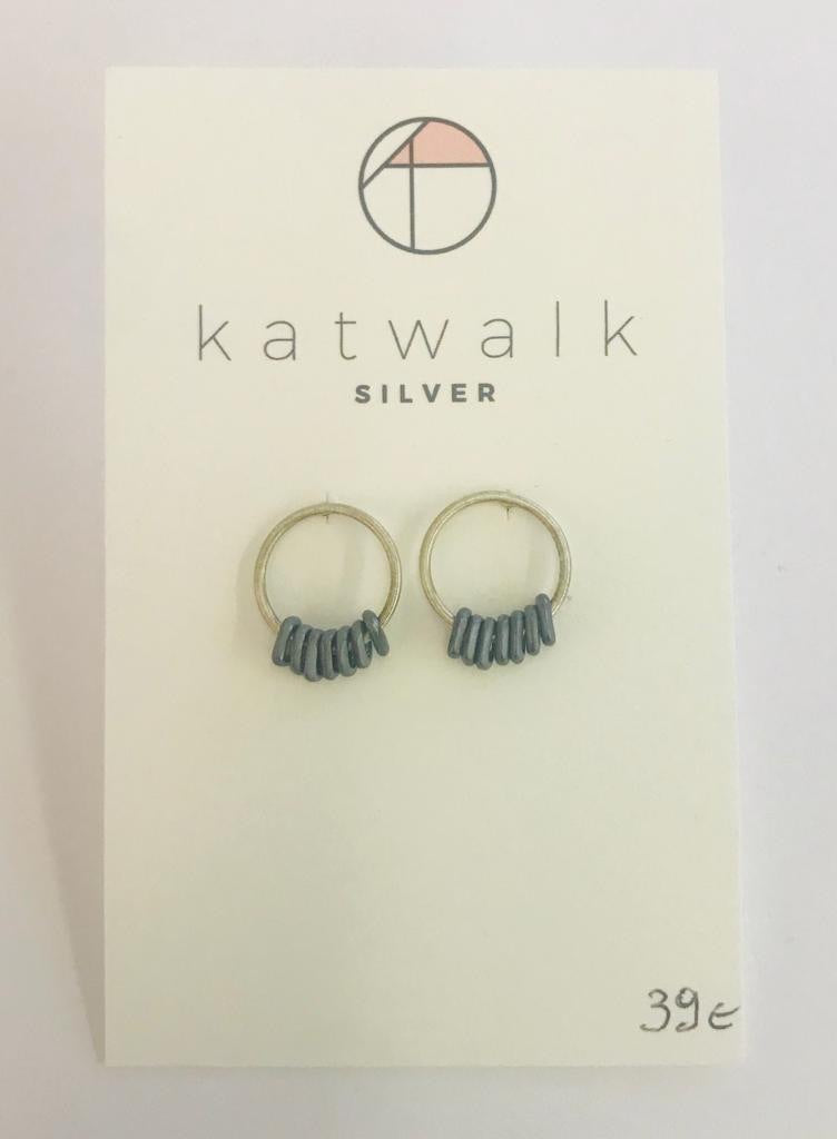 Sterling silver 925 simple hoops with tiny blue dangling rings by the Belgian brand Katwalk Silver.