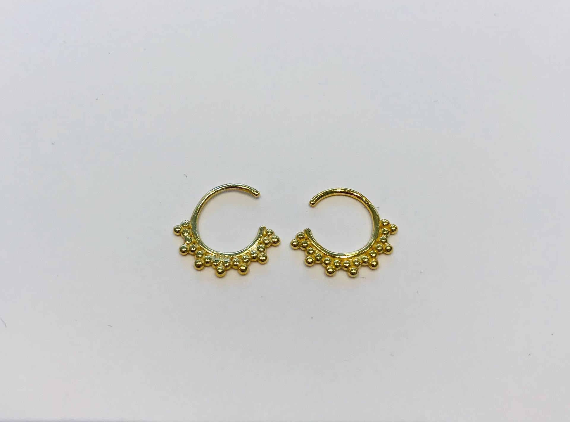 Small gold plated ring earrings by SAM&CEL which can be worn in multiple ways.