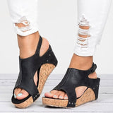 Riveted roman style walking sandals with large cutout lift wedges