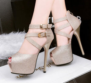 Platform spike high heels shoes with peep toes.