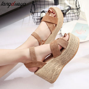Flock sandals with open toe, wedge platforms with layered sole look.