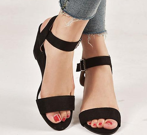 Low cut wedges with ankle straps and thick rubber soles.