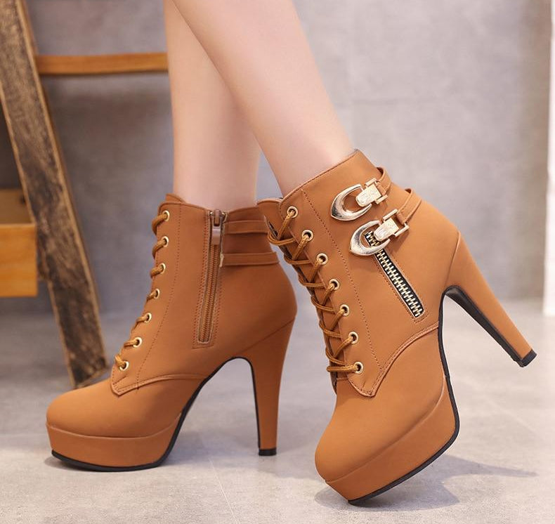 Thin extreme high heels ankle platform with rounded toes.