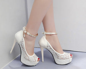 Lace stiletto pumps with ankle buckle strap, and crystal accents.