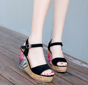 Colorful platform wedge style sandals, buckle strap platforms.