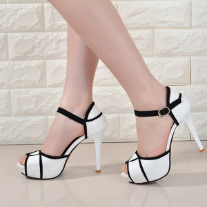 Spike heel pumps with peep toe, white on black or black on white style
