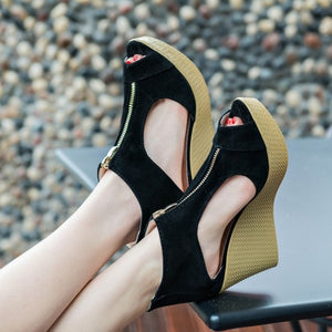 Flock open lift sandals summer platforms, with peep toes and large side cutouts.