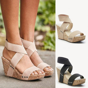 Elastic band riveted platform wedge sandals with stench fabric.