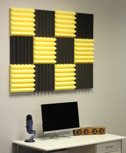 yellow and black soundproofing acoustic foam panels in recording studio