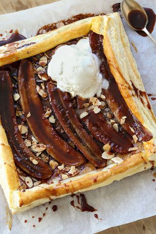 Banana Fosters Puff Pastry with Rum Sauce and Vanilla Ice Cream