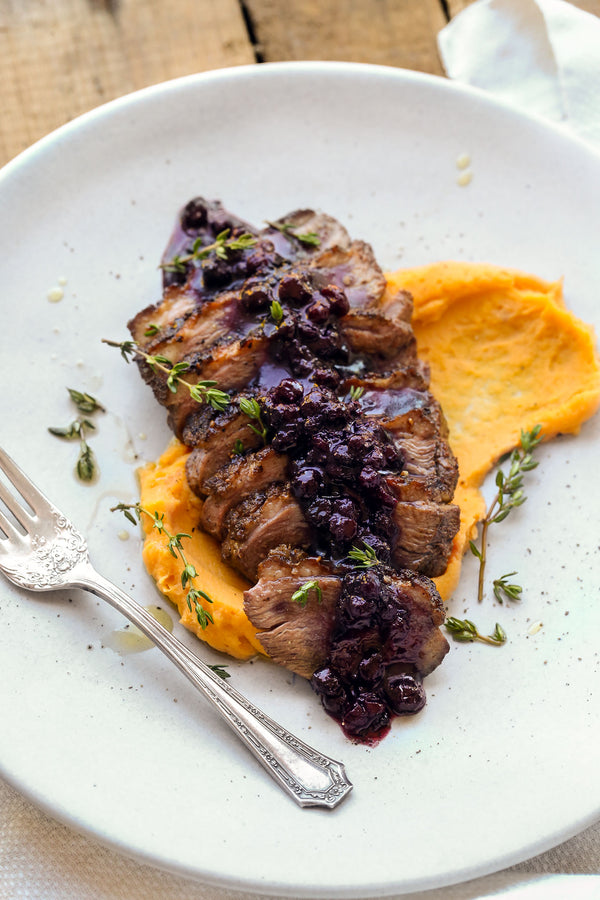 Pan Seared Spiced Duck Breast with Wild Blueberry Sauce and Sweet Potato Puree