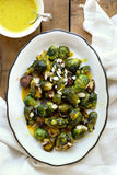 Pan Roasted Brussels Sprouts with Lemon Green Tahini and Honey Drizzle