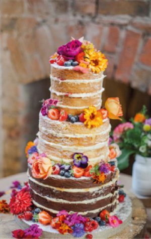 Stunning edible flower naked wedding cake from http://www.theorganicweddingcakecompany.com