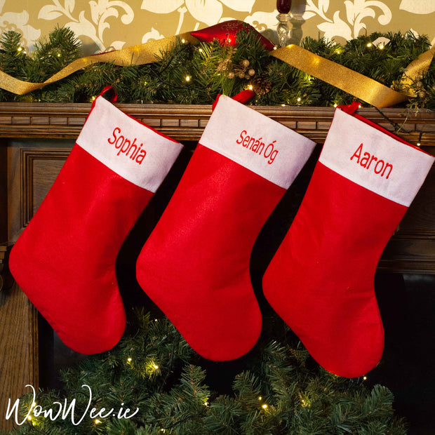 Personalised Christmas Stockings made from soft felt in traditional festive red and white colours. Beautifully embroidered to order with a name just for you by WowWee.ie