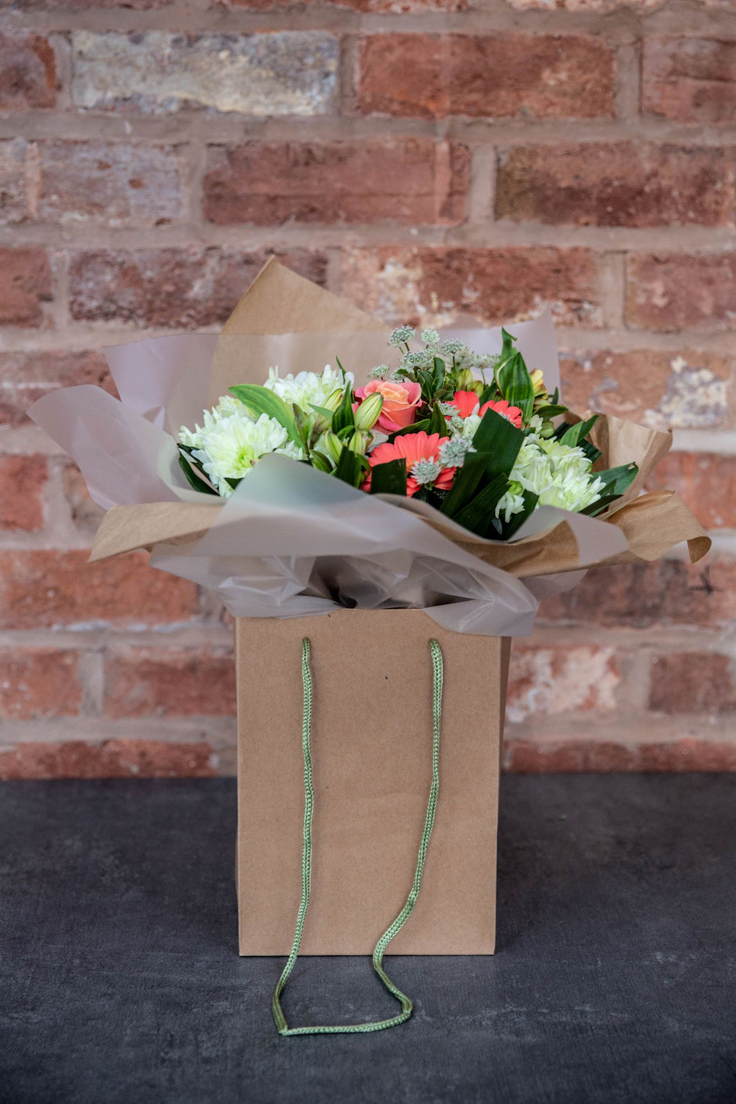 Coral rose and germini hand-tied bouquet