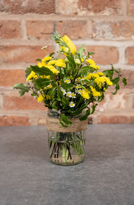 Yellow Tulips, Yellow tanacetum, yellow dainty chrysanthemums in a mason jar