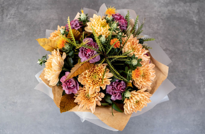 Golden Chrysanthemums, purple carnations, bouquet