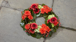Orange and scarlet funeral wreath