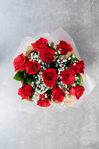 12 red roses with gypsophilia