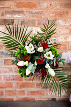 Load image into Gallery viewer, white lily, red rose, eucalyptus in a large hand tied bouquet