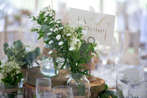 rustic jars & wooden table wedding centrepieces