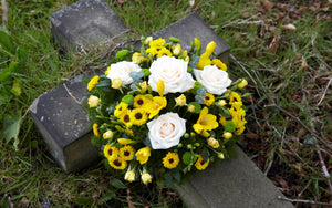 yellow bright funeral posy