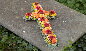 yellow orange funeral tribute cross