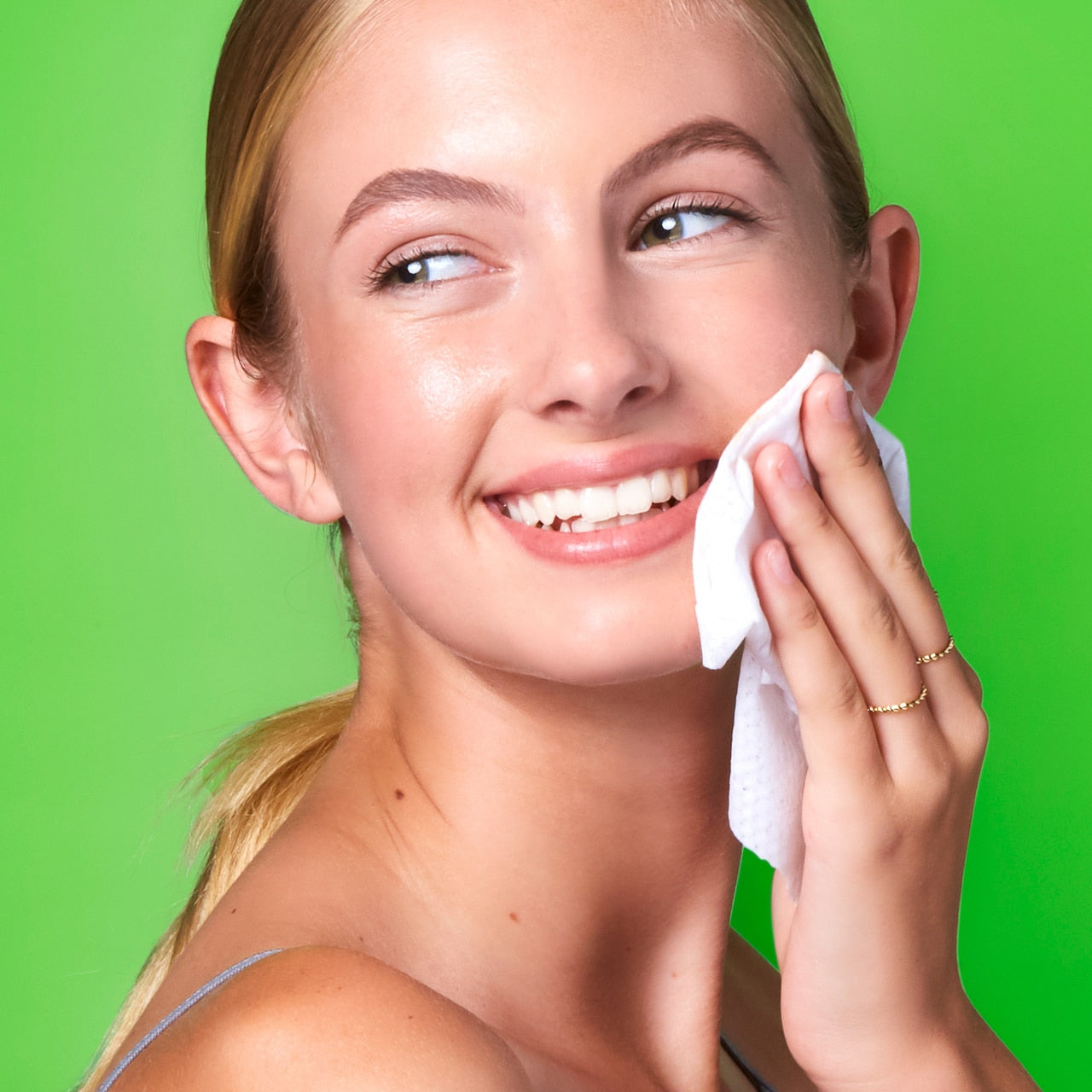 Girl using a Clarify Blemish Cleansing Wipes for Acne, 1% Salicylic Acid