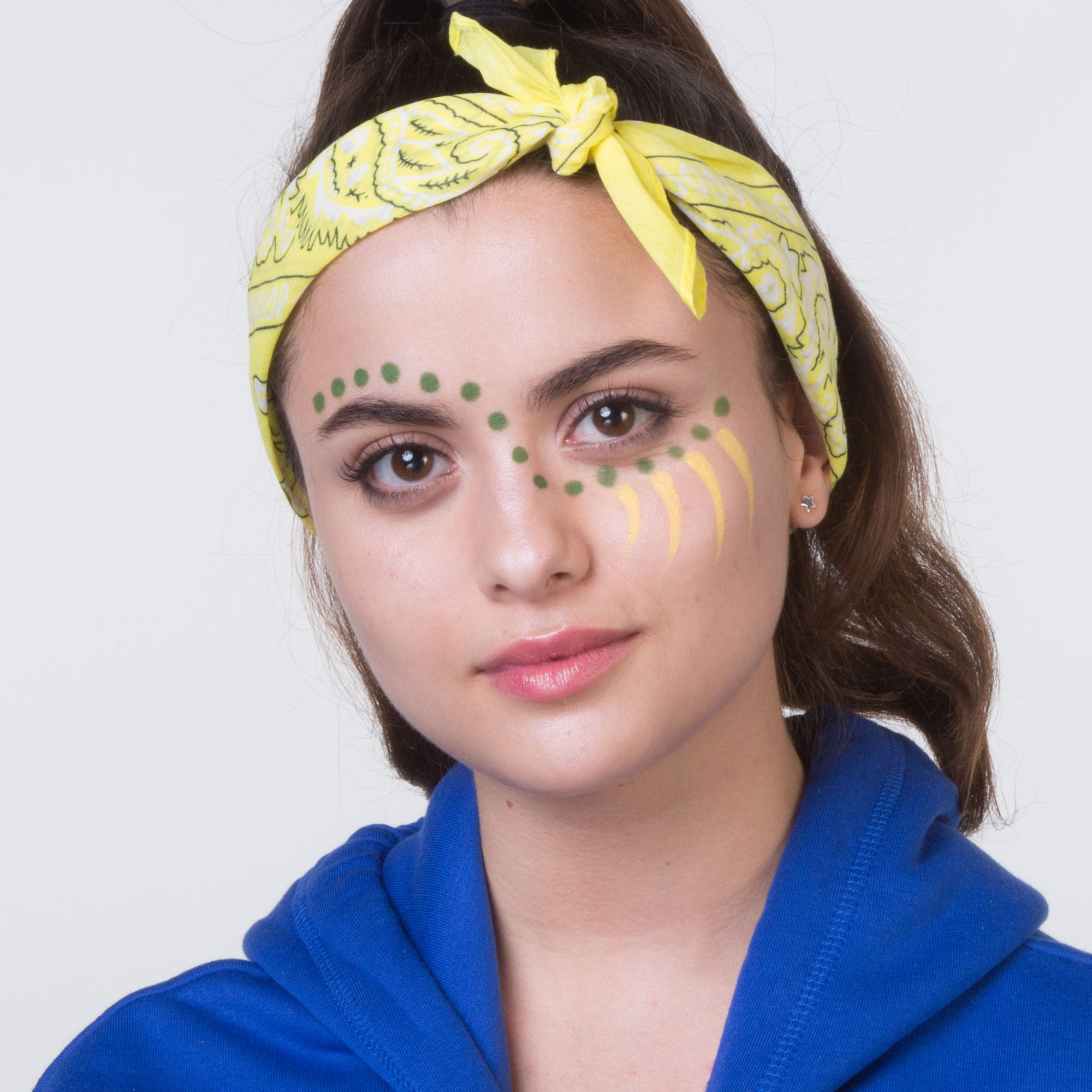 Girl with Visual Artist Makeup Crayon on face, school spirit