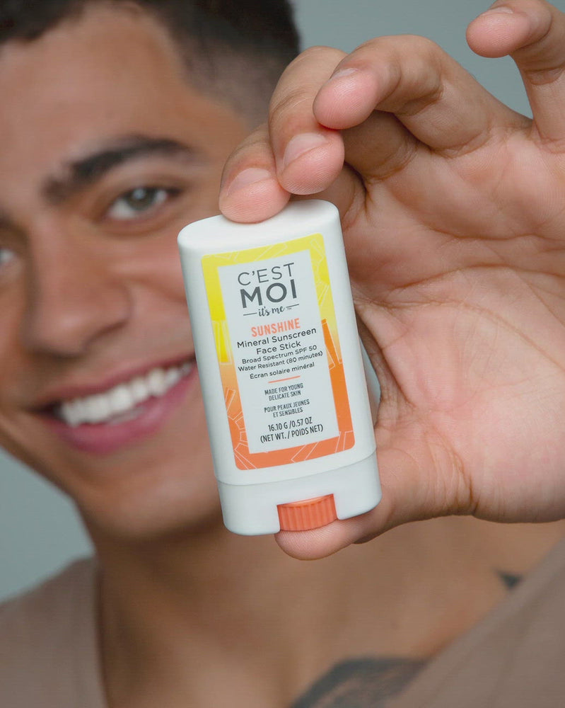 Model applying Sunshine Mineral Sunscreen Face Stick