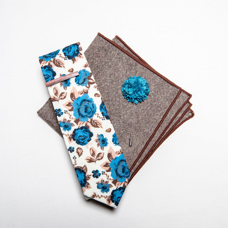 a men's accessories set - The earthy, wood tie bar along with the wool pocket square give rise to the bright, light blue flowers on the lapel pin and the floral tie