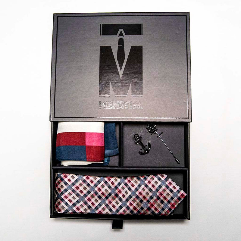 voyage set in box with top in a gift box - The silver helm lapel pin on the breast represents choice, while the anchor tie bar on the chest symbolizes strength. These two coupled with the versatile, multi-colored silk tie and silk pocket square make a great combination