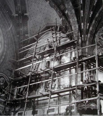 Americo Makk on scaffolding painting a mural in the cathedral in Jau, Brazil.
