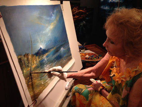 Eva Makk painting an oil painting of Waikiki with Diamond Head in the background.