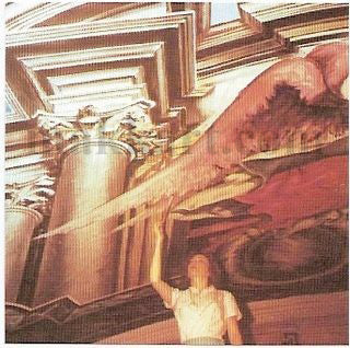Eva Makk painting an angel wing in the Manaus Brazil church ceiling mural