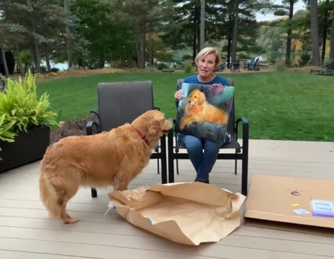 Simon the golden retriever looking at his portrait