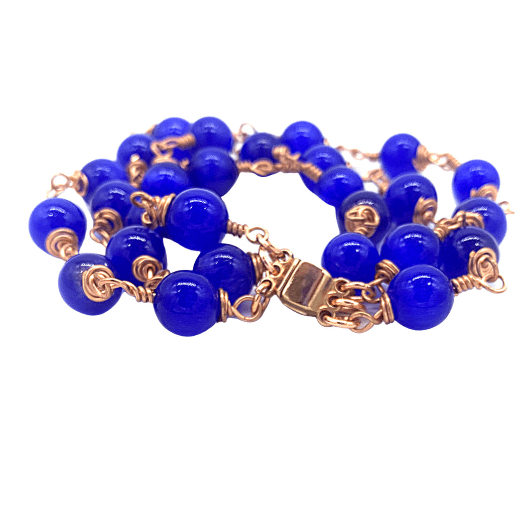 Blue beaded rose gold wire wrapped bracelet. Perfect for gifting. Donations for refugees in Austin Texas