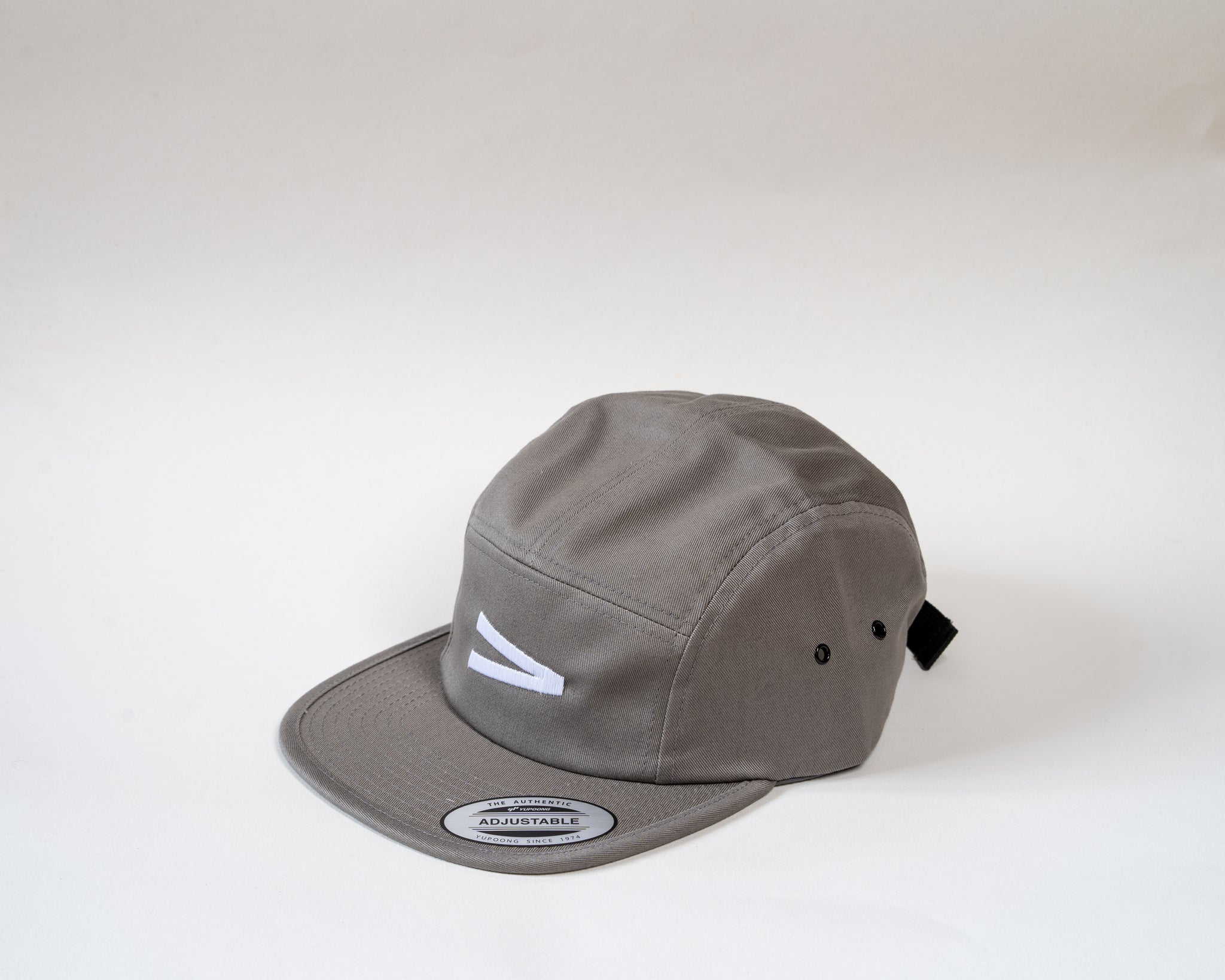 Grey 5 panel cap showcasing Jam logo A symbol on a white background