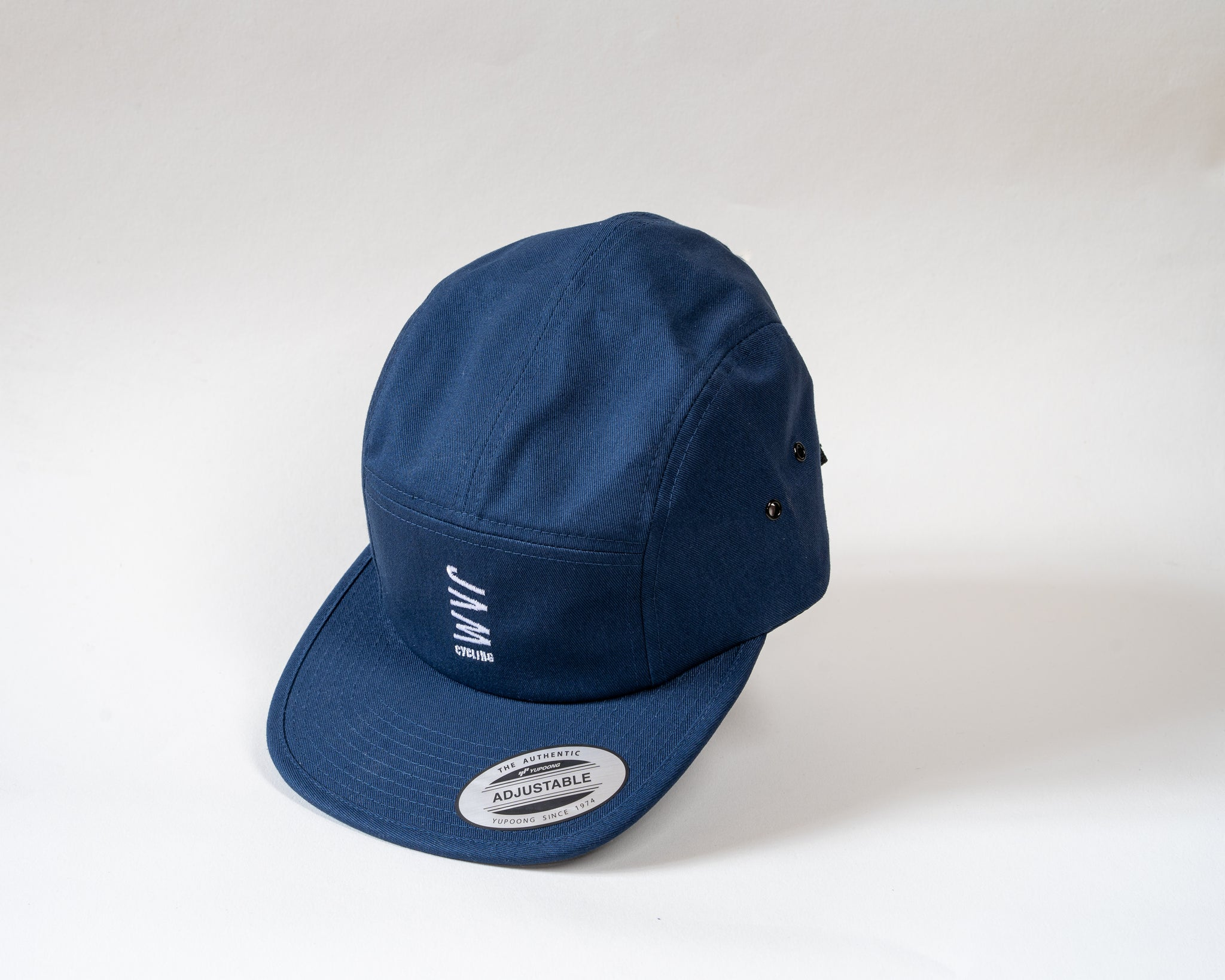 Navy 5 panel cap showcasing Jam logo symbol floating on a white background