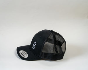 Side shot of Jam Trucker cap showcasing stitched Jam logo symbol and mesh rear panel sitting on a white background