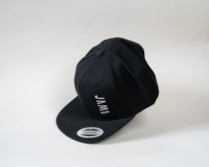 Jam Snapback cap showcasing Jam logo symbol floating on a white background