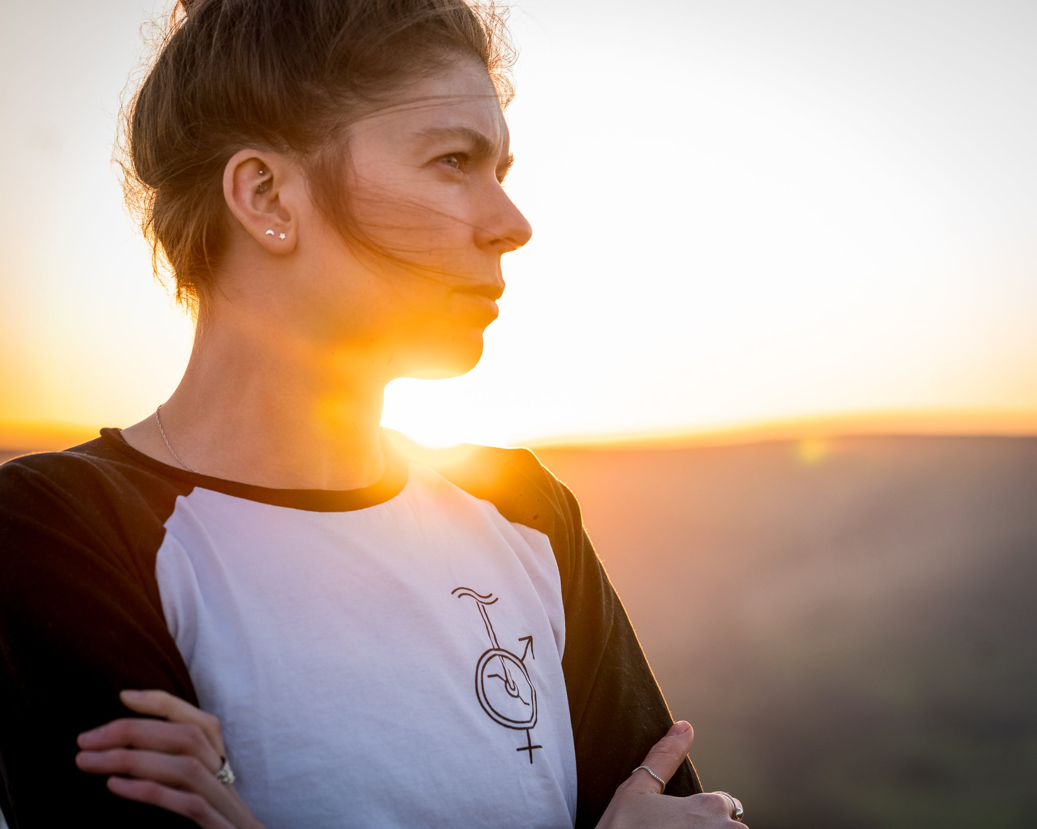 Unicycle baseball t-shirt sunset picture female employee looking powerful into the distance