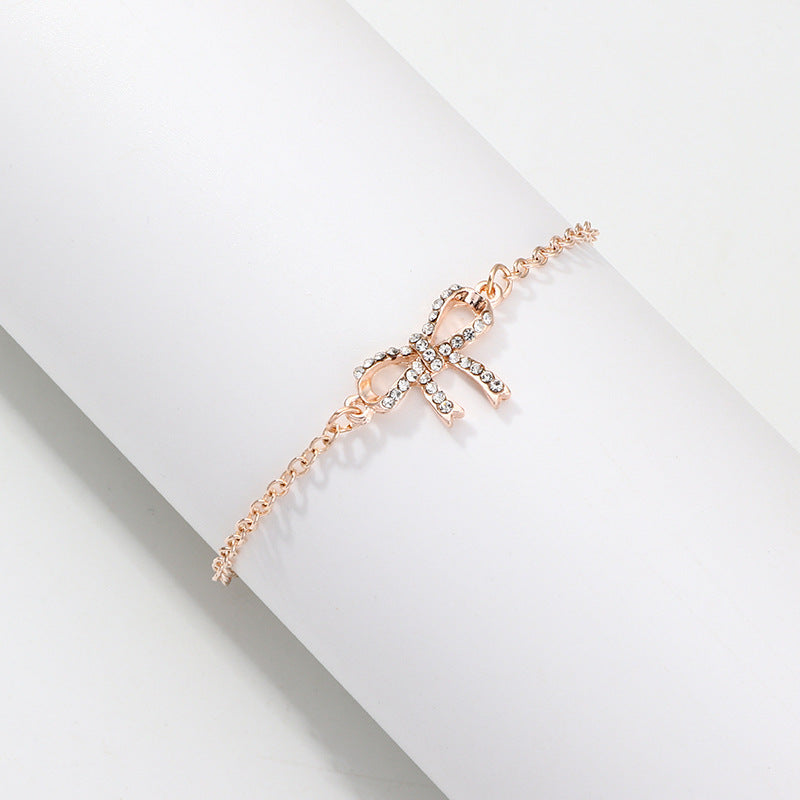 NIRUMON Diamond Inlaid Bow Pendant Golden Fashion Bracelet - NIRUMON