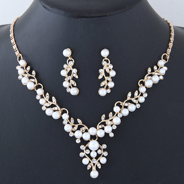 NIRUMON Pearl Studed Golden Statement Necklace & Earrings Set - NIRUMON