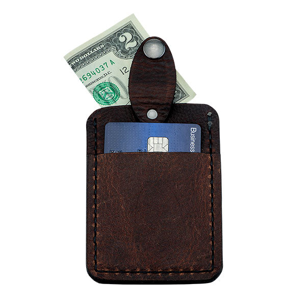 cash and credit card inside leather wallet
